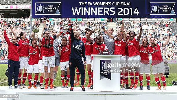 Kelly Smith Manager of Arsenal Ladies Shelley Kerr and team celebrate with the trophy during the FA Women's Cup final between Everton Ladies and...