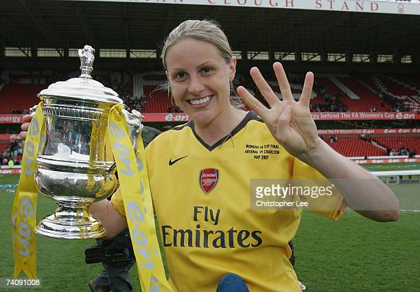 Kelly Smith of Arsenal celebrates with the trophy and signs the number four for them winning the Quadruple this year during the FA Womens Cup final...