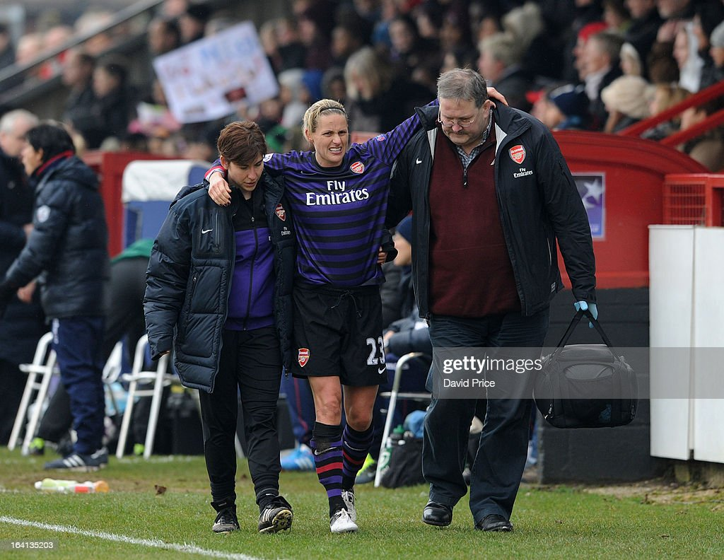 <a gi-track='captionPersonalityLinkClicked' href=/galleries/search?phrase=Kelly+Smith+-+Soccer+Player&family=editorial&specificpeople=221581 ng-click='$event.stopPropagation()'>Kelly Smith</a> of Arsenal Ladies FC is helped from the pitch by the Arsenal physios during the Women's Champions League Quarter Final match between Arsenal Ladies FC and ASD Torres CF at Meadow Park on March 20, 2013 in Borehamwood, United Kingdom.