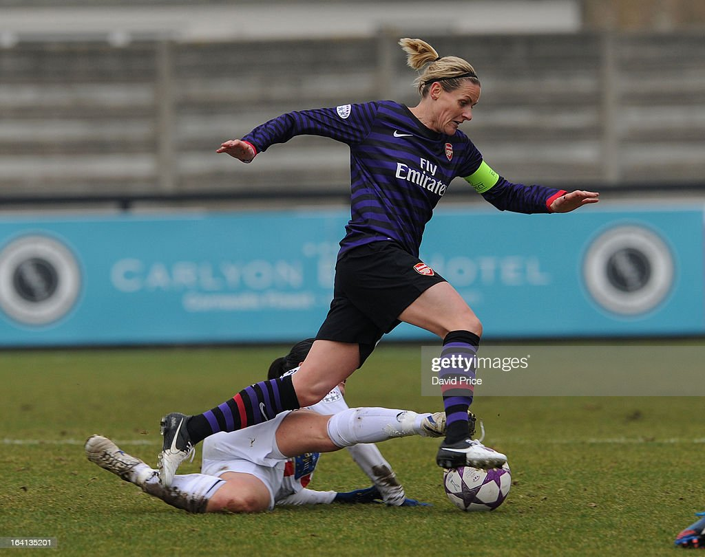 Kelly Smith of Arsenal Ladies FC is tackled by Giulia Domenichetti of Torres during the Women's Champions League Quarter Final match between Arsenal Ladies FC and ASD Torres CF at Meadow Park on March 20, 2013 in Borehamwood, United Kingdom.