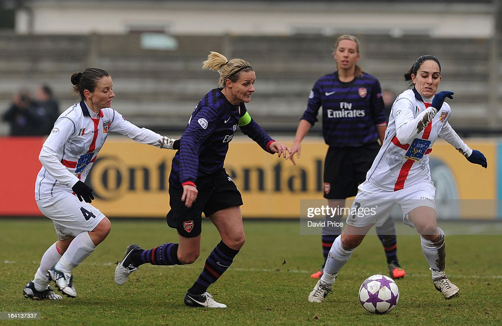 Kelly Smith of Arsenal Ladies FC vies with Daniela Stracchi (L) and Giulia Domenichetti (R) of Torres during the Women's Champions League Quarter Final match between Arsenal Ladies FC and ASD Torres CF at Meadow Park on March 20, 2013 in Borehamwood, United Kingdom.