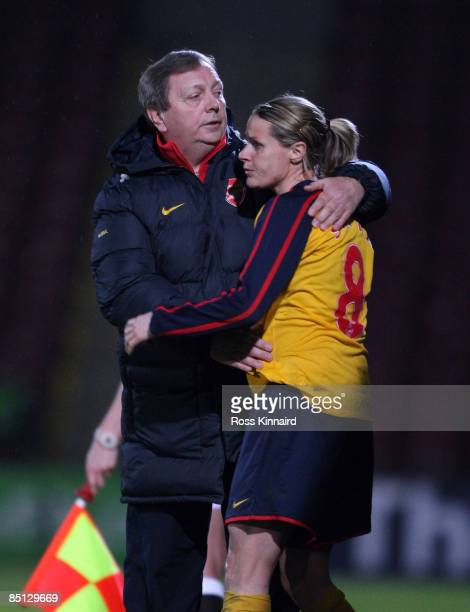 Kelly Smith of Arsenal LFC and manager Vic Akers hug during the FA Women's Premier League Cup Final between Arsenal and Doncaster Rovers Belles at...