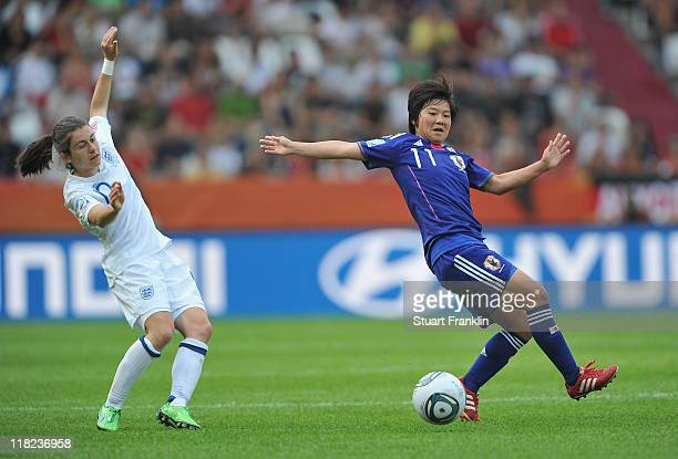 Kelly Smith of England is challenged by Shinobu Ohno of Japan during the FIFA Women's World Cup 2011 group B match between England and Japan at the...