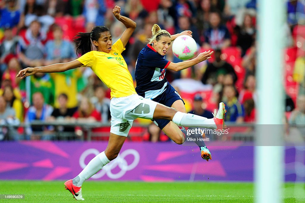 Kelly Smith #10 of Great Britain shoots at goal uinder pressure from Bruna #14 of Brazil during the Women's Football first round Group E Match between Great Britain and Brazil on Day 4 of the London 2012 Olympic Games at Wembley Stadium on July 31, 2012 in London, England.