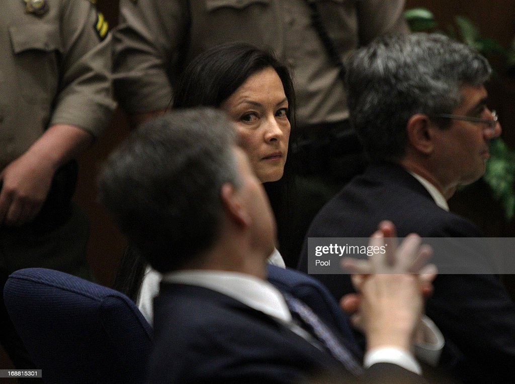 Kelly Soo Park glances at her lawyer George Buehler (L), as they and her other lawyer Mark Kassabian (R) listen to opening statements on May 15, 2013 in Los Angeles, California. Park is charged with the killing of aspiring model and actress Juliana Redding in 2008.