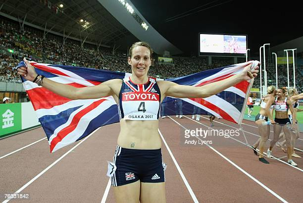 Kelly Sotherton of Great Britain celebrates taking third place overall following the 800m event during the Women's Heptathlon on day two of the 11th...