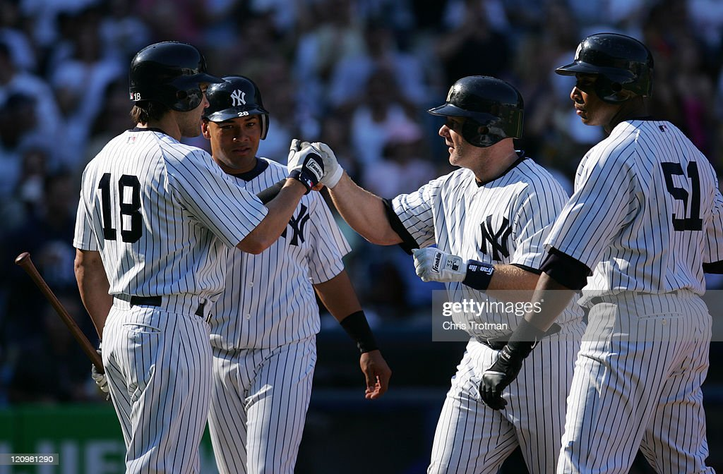 Kelly Stinnett #33 of the New York Yankees is congratulated by teammate <a gi-track='captionPersonalityLinkClicked' href=/galleries/search?phrase=Johnny+Damon&family=editorial&specificpeople=167164 ng-click='$event.stopPropagation()'>Johnny Damon</a> #18 after a home run on a fly ball to left field in the third inning. <a gi-track='captionPersonalityLinkClicked' href=/galleries/search?phrase=Bernie+Williams&family=editorial&specificpeople=175814 ng-click='$event.stopPropagation()'>Bernie Williams</a> and <a gi-track='captionPersonalityLinkClicked' href=/galleries/search?phrase=Melky+Cabrera&family=editorial&specificpeople=453444 ng-click='$event.stopPropagation()'>Melky Cabrera</a> score against the Kansas City Royals at Yankee Stadium on May 27, 2006 in the Bronx Borough of New York City.The Yankees defeated the Royals 15-4.