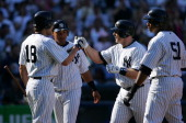 Kelly Stinnett of the New York Yankees is congratulated by teammate Johnny Damon after a home run on a fly ball to left field in the third inning...
