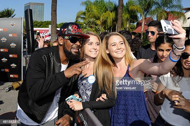 Kelly takes a selfie at 'Extra' at Universal Studios Hollywood on October 6 2015 in Universal City California