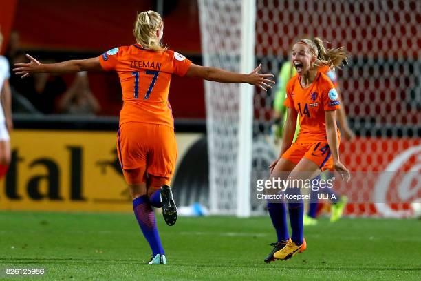 Kelly Zeeman and Jackie Groenen of the Netherlands celebrate after winning 30 the UEFA Women's Euro 2017 Second Semi Final match between Netherlands...