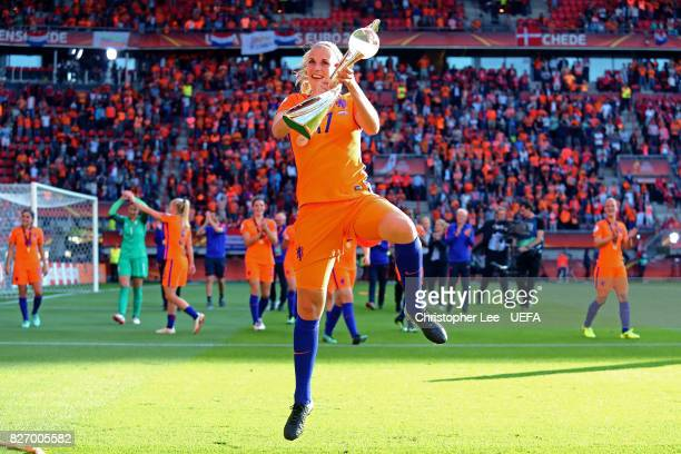 Kelly Zeeman of the Netherlands celebrates with the trophy following the Final of the UEFA Women's Euro 2017 between Netherlands v Denmark at FC...