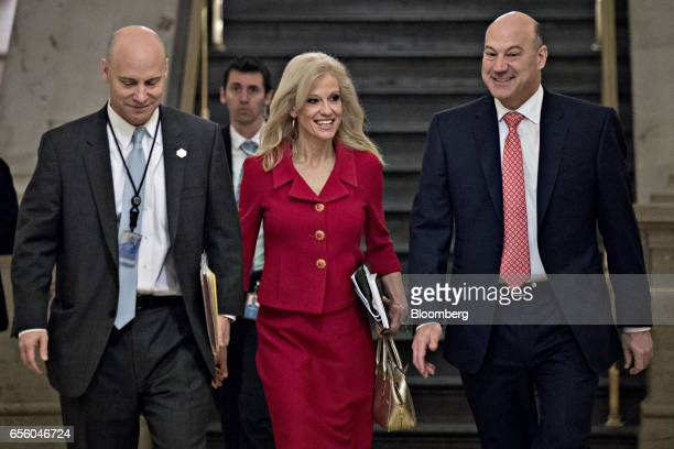Kellyanne Conway senior advisor to US President Donald Trump center and Gary Cohn director of the US National Economic Council right walk to a House...