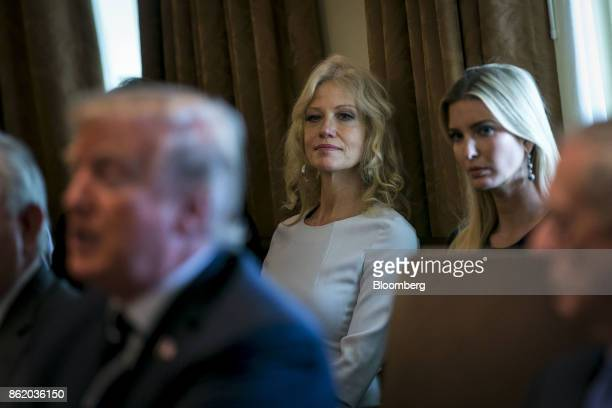 Kellyanne Conway senior advisor to US President Donald Trump center and Ivanka Trump assistant to US President Donald Trump listen as US President...