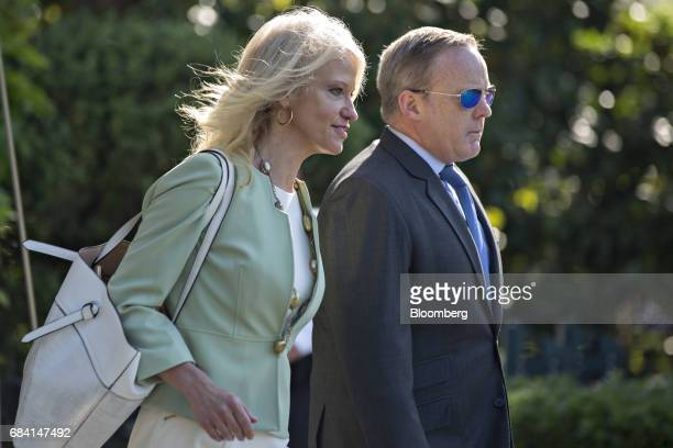 Kellyanne Conway senior advisor to US President Donald Trump left and Sean Spicer White House press secretary walk towards Marine One on the South...
