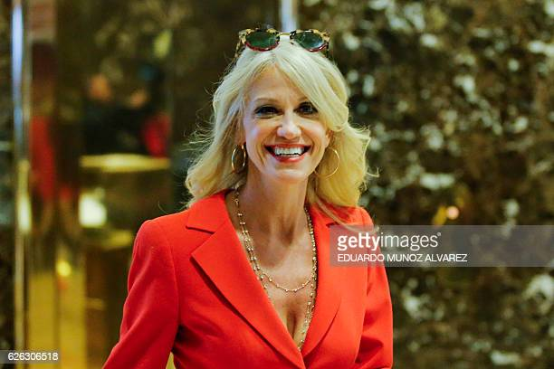Kellyanne Conway senior advisor to US Presidentelect Donald Trump's transition team exits the elevators during meetings on November 28 2016 at Trump...