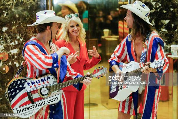 Kellyanne Conway senior advisor to US Presidentelect Donald Trump's transition team jokes with two 'Naked Cowboys' after she exits the elevators...