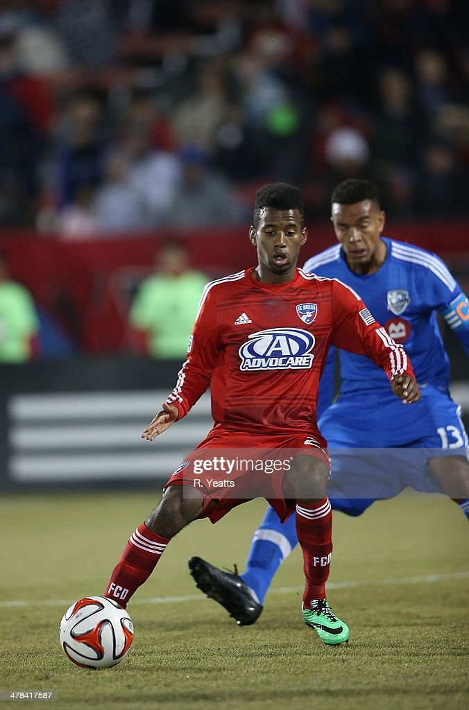 Kellyn Acosta of FC Dallas defends the ball from Matteo Ferrari of Montreal Impact at Toyota Stadium on March 8 2014 in Frisco Texas