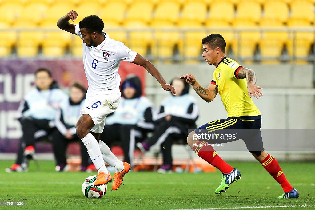 Kellyn Perry of USA controls the ball under pressure from Juan Quintero of Colombia during the FIFA U20 World Cup New Zealand 2015 Round of 16 match...