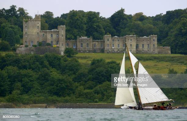 Kelpie competing in the British Classic Yacht Club regatta passes Norris Castle in Osborne Bay during racing on The Solent near Cowes Isle of Wight