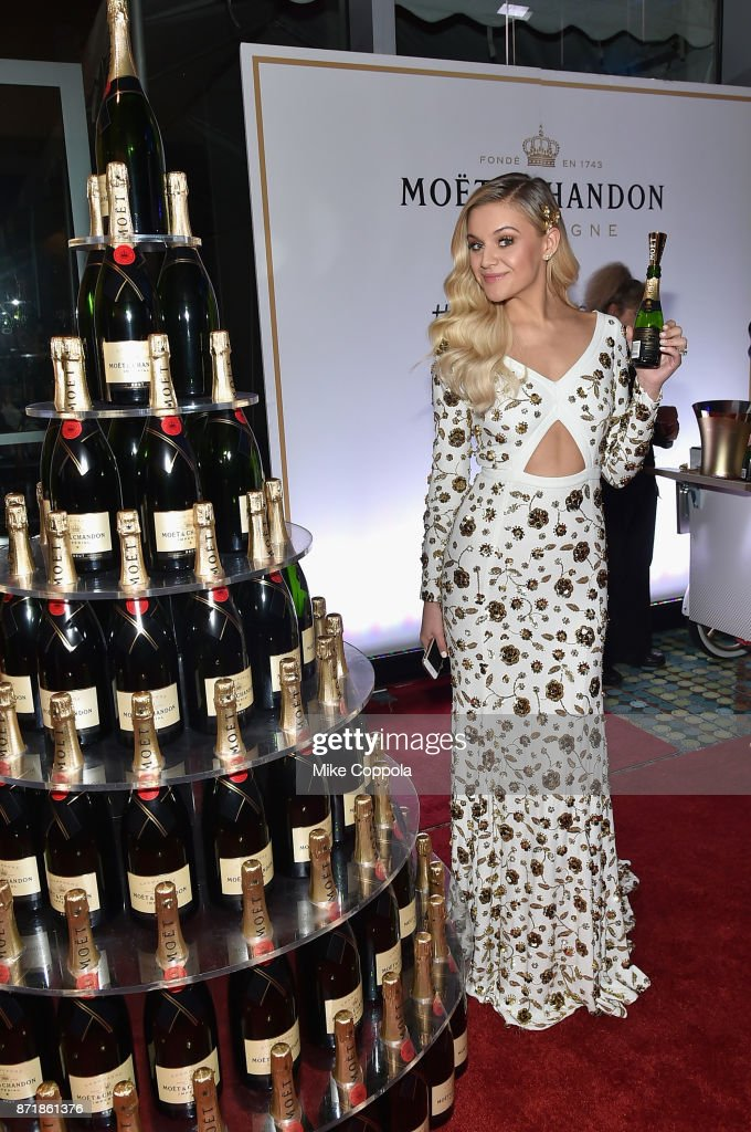 Kelsea Ballerini poses with Moet & Chandon during the 51st Annual CMA Awards at Bridgestone Arena on November 8, 2017 in Nashville, Tennessee.