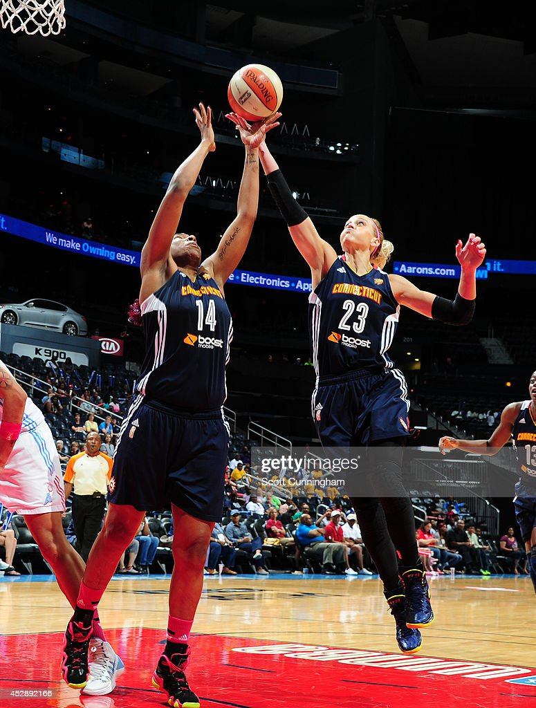 Kelsey Bone #14 and Katie Douglas #23 of the Connecticut Sun grab a rebound against the Atlanta Dream on July 29, 2014 at Philips Arena in Atlanta, Georgia.