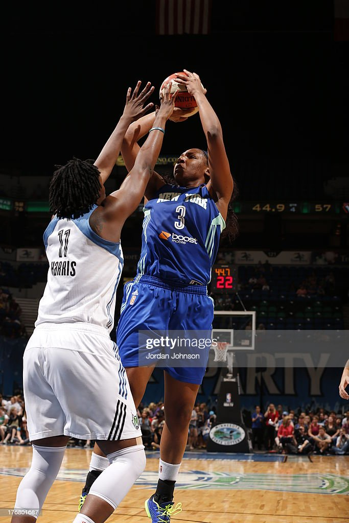 <a gi-track='captionPersonalityLinkClicked' href=/galleries/search?phrase=Kelsey+Bone&family=editorial&specificpeople=5792056 ng-click='$event.stopPropagation()'>Kelsey Bone</a> #3 New York Liberty shoots against <a gi-track='captionPersonalityLinkClicked' href=/galleries/search?phrase=Amber+Harris&family=editorial&specificpeople=2225907 ng-click='$event.stopPropagation()'>Amber Harris</a> #11 of the Minnesota Lynx during the WNBA game on August 18, 2013 at Target Center in Minneapolis, Minnesota.