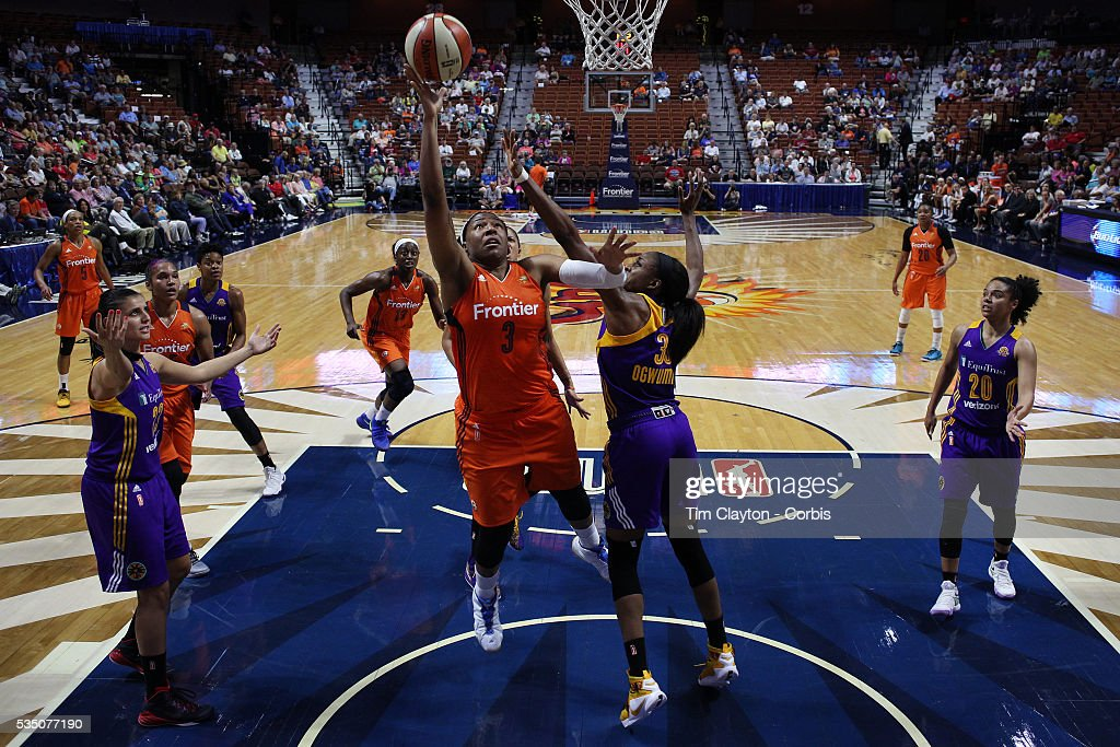Kelsey Bone #3 of the Connecticut Sun drives to the basket past Nneka Ogwumike #30 of the Los Angeles Sparks during the Los Angeles Sparks Vs Connecticut Sun, WNBA regular season game at Mohegan Sun Arena on May 26, 2016 in Uncasville, Connecticut.