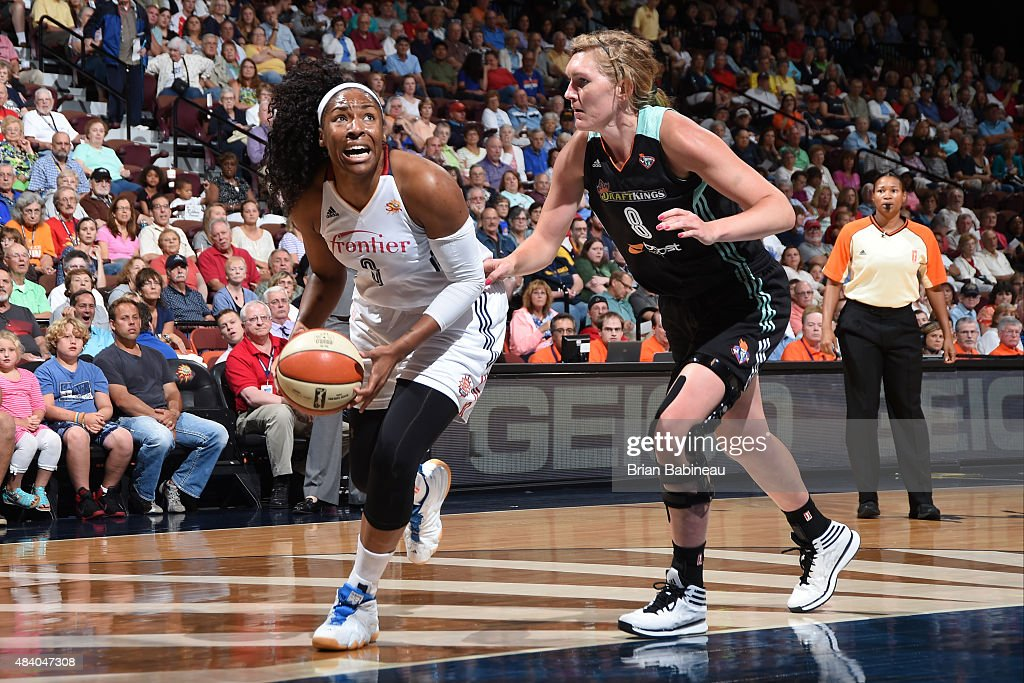 <a gi-track='captionPersonalityLinkClicked' href=/galleries/search?phrase=Kelsey+Bone&family=editorial&specificpeople=5792056 ng-click='$event.stopPropagation()'>Kelsey Bone</a> #3 of the Connecticut Sun handles the ball against Carolyn Swords #8 of the New York Liberty at the Mohegan Sun Arena on August 14, 2015 in Uncasville, Connecticut.