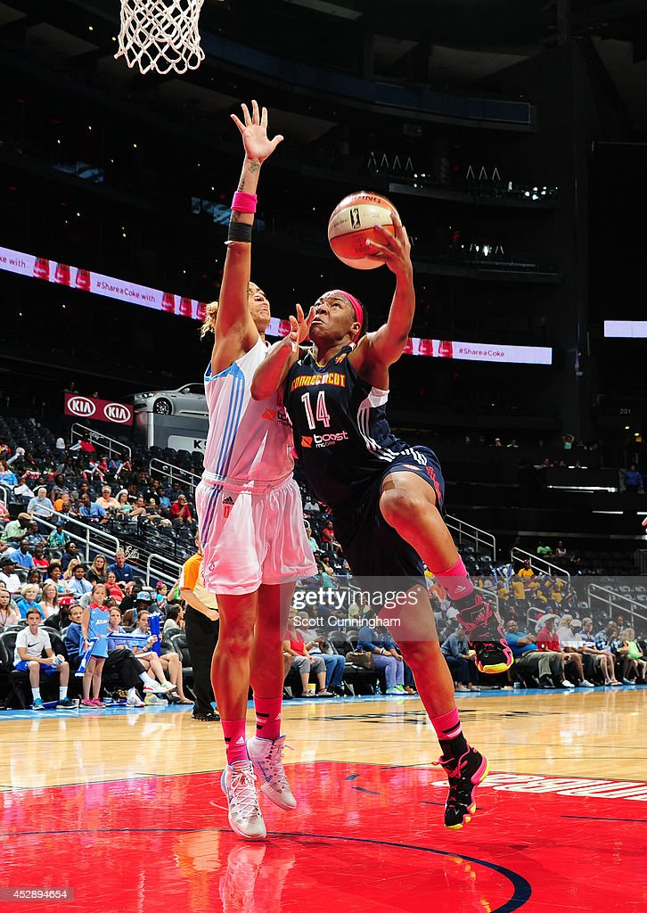 Kelsey Bone #14 of the Connecticut Sun puts up a shot against the Atlanta Dream on July 29, 2014 at Philips Arena in Atlanta, Georgia.