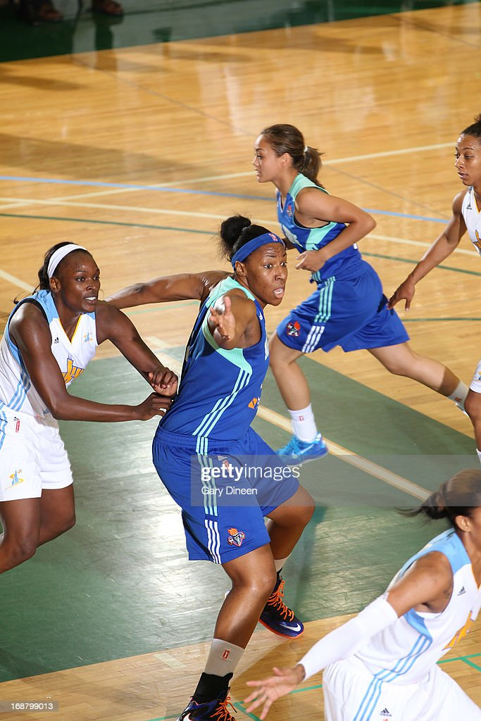 <a gi-track='captionPersonalityLinkClicked' href=/galleries/search?phrase=Kelsey+Bone&family=editorial&specificpeople=5792056 ng-click='$event.stopPropagation()'>Kelsey Bone</a> #3 of the New York Liberty calls for the ball while guarded by <a gi-track='captionPersonalityLinkClicked' href=/galleries/search?phrase=Sylvia+Fowles+-+Basketball+Player&family=editorial&specificpeople=707903 ng-click='$event.stopPropagation()'>Sylvia Fowles</a> #34 during the pre-season game on May 15, 2013 at the Jacoby D. Dickens Physical Education and Athletic Center on the campus of Chicago State University in Chicago, Illinois.