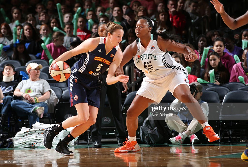 Kelsey Griffin #5 of the Connecticut Sun drives to the basket against Kara Braxton #45 of the New York Liberty at the Madison Square Garden on May 8, 2014 in New York, NY.