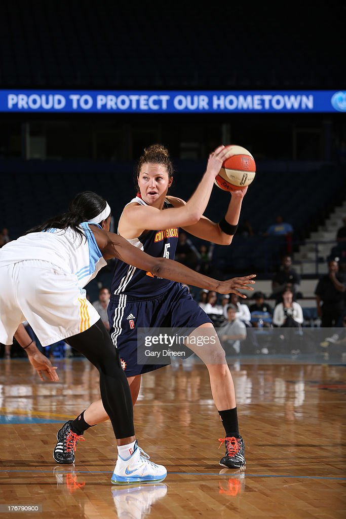 Kelsey Griffin #5 of the Connecticut Sun prepares to drive on <a gi-track='captionPersonalityLinkClicked' href=/galleries/search?phrase=Swin+Cash&family=editorial&specificpeople=202486 ng-click='$event.stopPropagation()'>Swin Cash</a> #8 of the Chicago Sky during the game on August 18, 2013 at the Allstate Arena in Rosemont, Illinois.