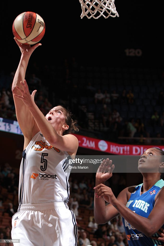 Kelsey Griffin #5 of the Connecticut Sun shoots a layup in front of Kara Braxton #45 of the New York Liberty during a game at the Mohegan Sun Arena on August 25, 2013 in Uncasville, Connecticut.