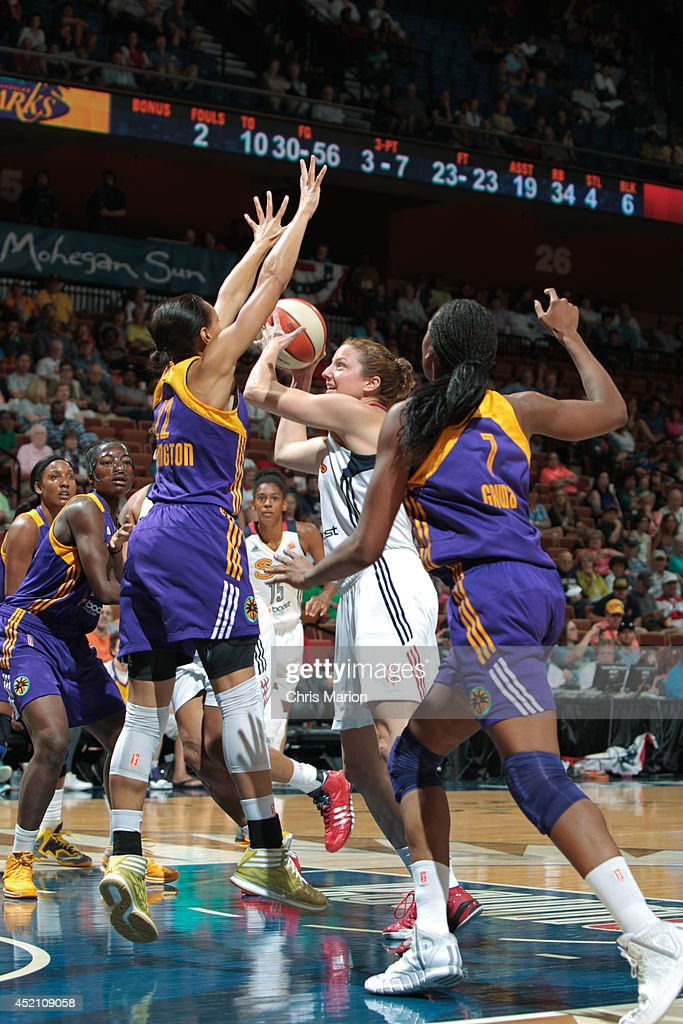 Kelsey Griffin #5 of the Connecticut Sun takes a shot challenged by Arminitie Herrington #22 of the Los Angeles Sparks during a game at the Mohegan Sun Arena on July 13, 2014 in Uncasville, Connecticut.