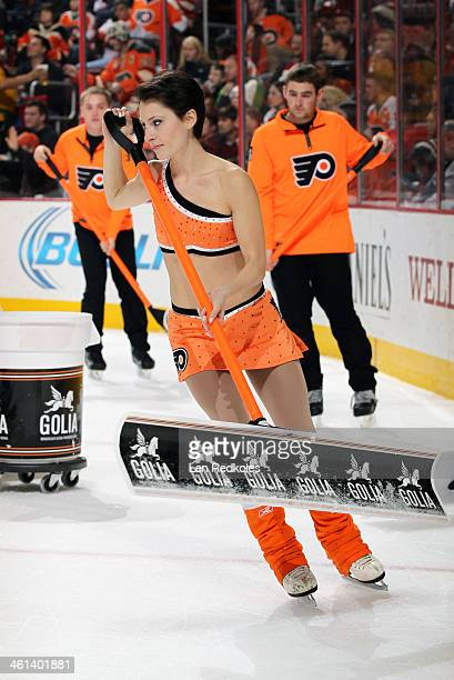 Kelsey Hoffman of the Philadelphia Flyers ice girls cleans the ice during a timeout against the Minnesota Wild on December 23 2013 at the Wells Fargo...