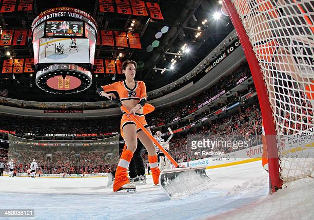 Kelsey Hoffman of the Philadelphia Flyers ice girls cleans the ice during a timeout against of the Chicago Blackhawks on March 18 2014 at the Wells...