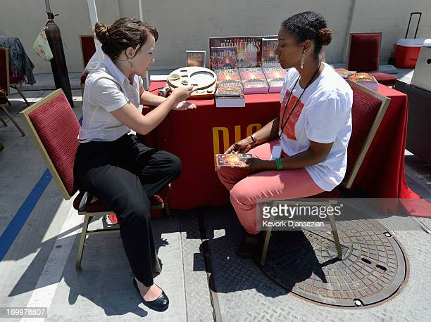 Kelsey Miller which Church of Scientology performs a stress for Mimi Lockert during a health fair sponsored by World Literacy Crusade and the...