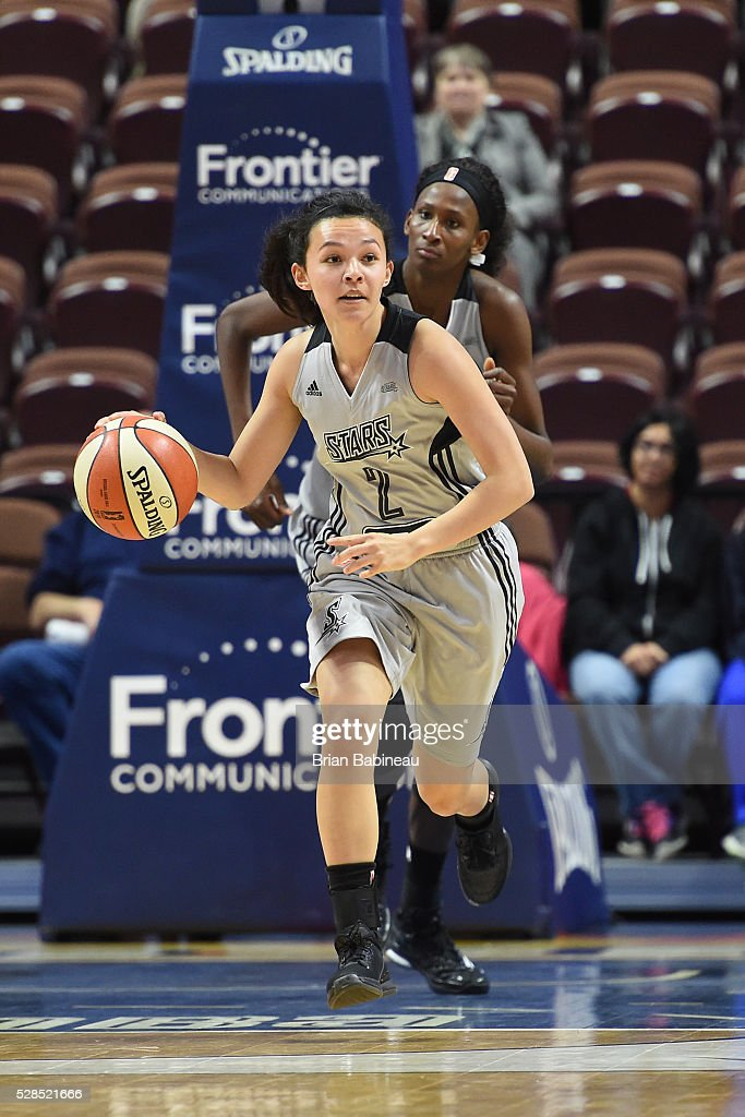 Kelsey Minato #2 of the San Antonio Stars handles the ball against the Connecticut Sun in a WNBA preseason game on May 5, 2016 at the Mohegan Sun Arena in Uncasville, Connecticut.