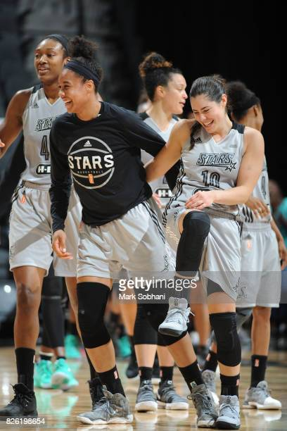 Kelsey Plum of the San Antonio Stars and Nia Coffey of the San Antonio Stars react during the game against the New York Liberty during a WNBA game on...