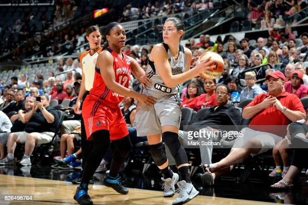 Kelsey Plum of the San Antonio Stars handles the ball against Ivory Latta of the Washington Mystics during a WNBA game on August 4 2017 at the ATT...
