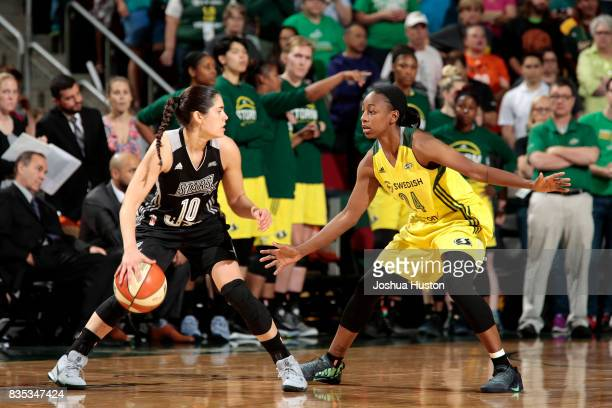 Kelsey Plum of the San Antonio Stars handles the ball against Jewell Loyd of the Seattle Storm during a WNBA game on August 18 2017 at Key Arena in...