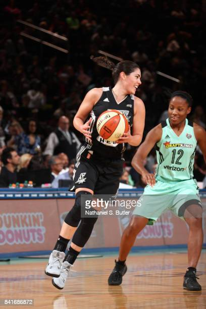 Kelsey Plum of the San Antonio Stars handles the ball against Lindsay Allen of the New York Liberty on September 1 2017 at Madison Square Garden in...