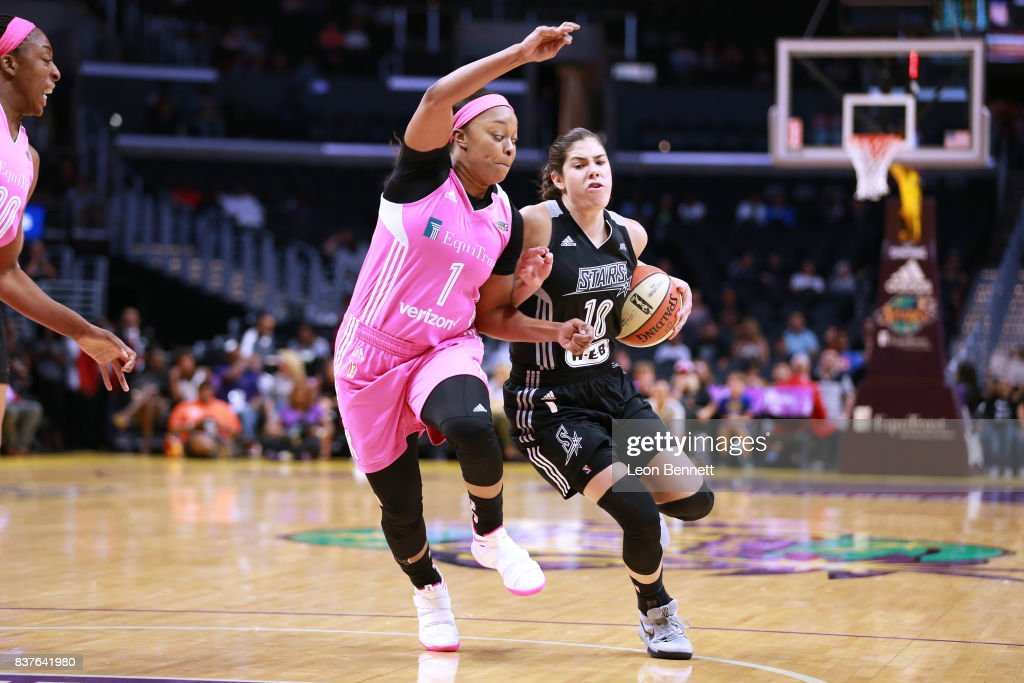 Kelsey Plum #10 of the San Antonio Stars handles the ball against Odyssey Sims #0 of the Los Angeles Sparks during a WNBA game at Staples Center on August 22, 2017 in Los Angeles, California.
