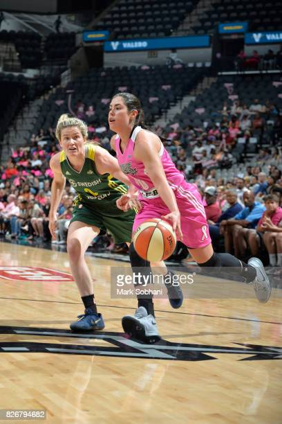 Kelsey Plum of the San Antonio Stars handles the ball against Sami Whitcomb of the Seattle Storm on August 5 2017 at the ATT Center in San Antonio...