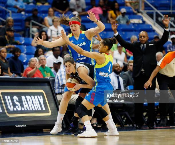 Kelsey Plum of the San Antonio Stars handles the ball against Theresa Plaisance and Skylar DigginsSmith of the Dallas Wings on June 21 2017 at...