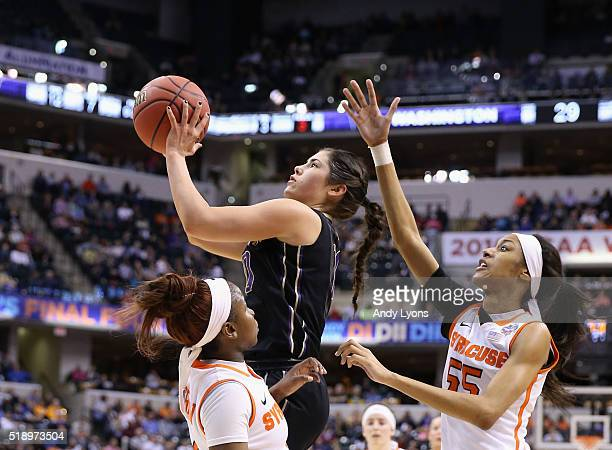 Kelsey Plum of the Washington Huskies shoots against Julia Chandler and Bria Day of the Syracuse Orange in the first quarter during the semifinals of...