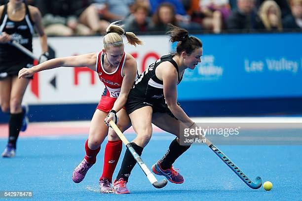 Kelsey Smith of New Zealand and Stefanie Fee of the USA battle for the ball during the FIH Women's Hockey Champions Trophy 2016 match between the USA...