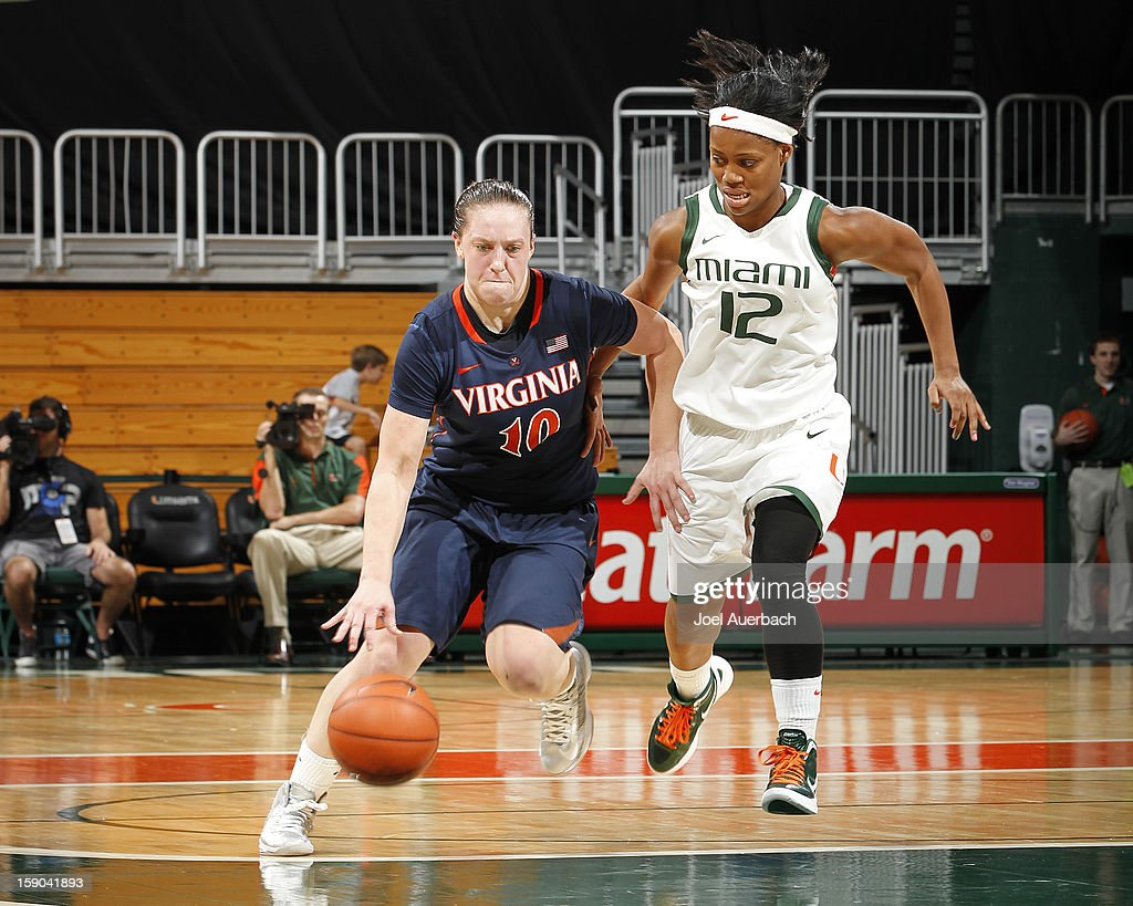 Kelsey Wolfe #10 of the Virginia Cavaliers brings the ball past Krystal Saunders #12 of the Miami Hurricanes on January 6, 2013 at the BankUnited Center in Coral Gables, Florida. The Hurricanes defeated the Cavaliers 58-52.