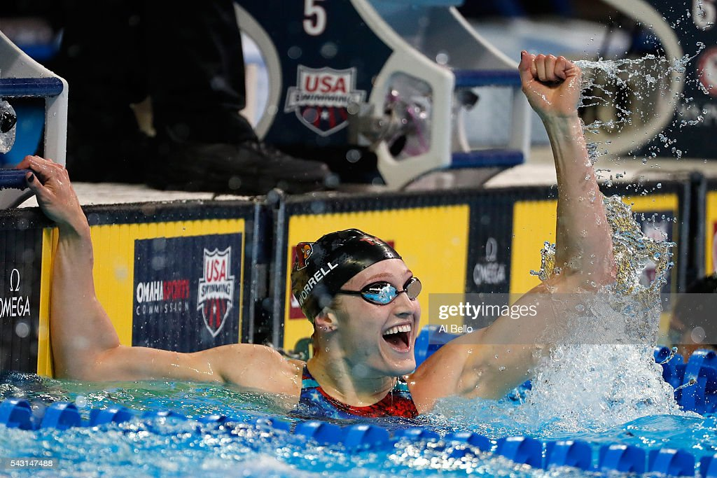 Kelsi Worrell of the United States celebrates after competing in a preliminary heat for the Women's 100 Meter Butterfly during Day One of the 2016 U.S. Olympic Team Swimming Trials at CenturyLink Center on June 26, 2016 in Omaha, Nebraska.