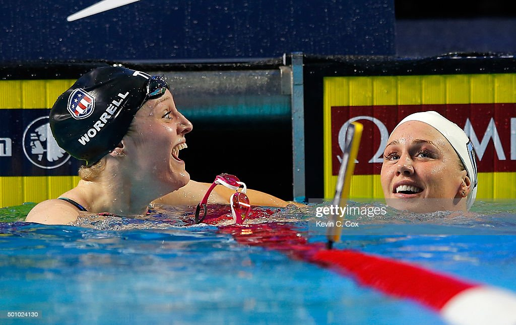 Kelsi Worrell reacts after breaking the American Record in her second place finish to Jeanette Ottesen of Denmark in the Women's 100m Butterfly during day one of the Mutual of Omaha Duel in the Pool at Indiana University Natatorium on December 11, 2015 in Indianapolis, Indiana.